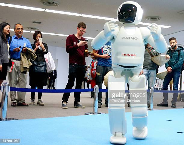 Honda Motor Co's humanoid robot ASIMO attracts visitors at the immigration of the Narita International Airport on March 28 2016 in Narita Chiba Japan