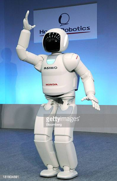 Honda Motor Co's new ASIMO robot demonstrates sign language during a news conference in Wako City Saitama Prefecture Japan on Tuesday Nov 8 2011...