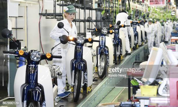 Honda Motor Co's new Super Cub motorcycle model rolls off the production line at the company's factory in Otsu Kumamoto Prefecture southwestern Japan...