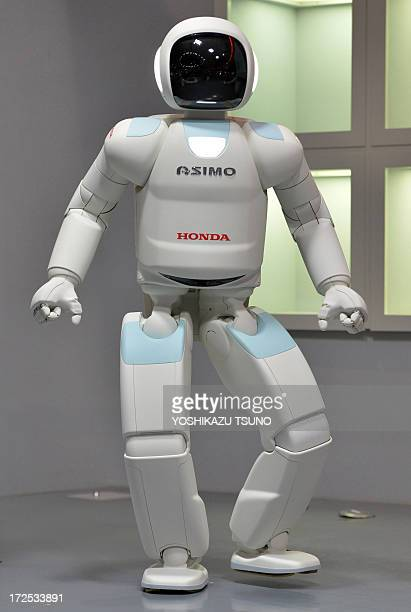 Honda Motor's humanoid robot Asimo interacts with visitors at the National Museum of Emerging Science and Innovation in Tokyo on July 3 2013 Honda...