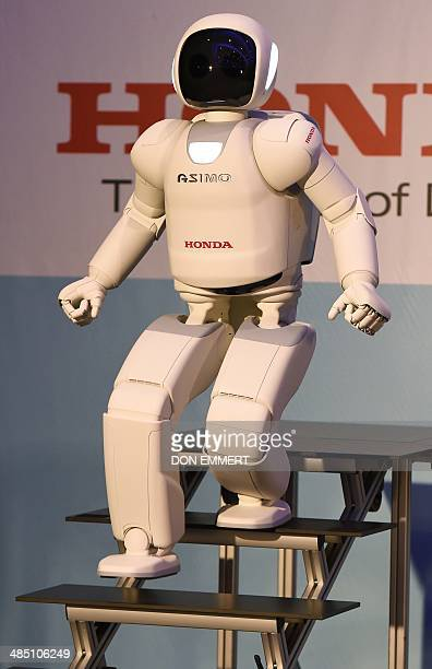 Honda North America makes their North American debut of their new Asimo Robot as it demonstrates its ability to walk down stairs at a news conference...