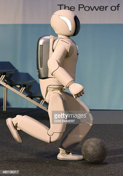 Honda North America makes their North American debut of their new Asimo Robot as it demonstrates its ability to kick a ball at a news conference...