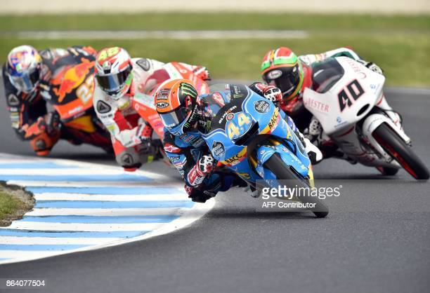 Honda rider Aron Canet of Spain leads a pack next to KTM rider Darryn Binder of South Africa during the Moto3class third practice session of the...