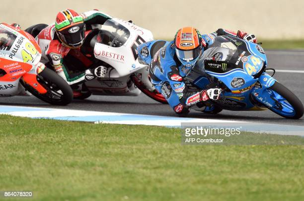 Honda rider Aron Canet of Spain leads and KTM rider Darryn Binder of South Africa negotiate a corner during the Moto3class third practice session of...