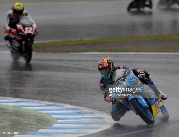 Honda rider Aron Canet of Spain leads Mahindra rider Marco Bezzecchi of Italy during the Moto3 class of the MotoGP Japanese Grand Prix at Twin Ring...
