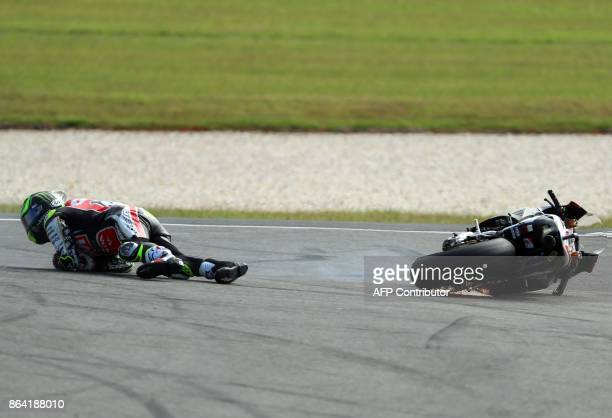 LCR Honda rider Cal Crutchlow of Britain crashes during the second qualifying session of the Australian MotoGP Grand Prix at Phillip Island on...