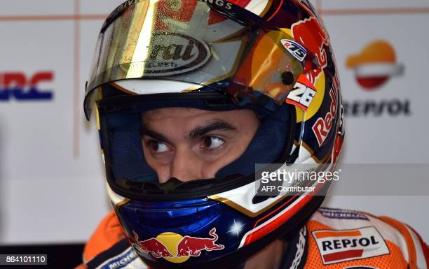 Honda rider Dani Pedrosa of Spain gets ready to ride during the third practice session of the Australian MotoGP Grand Prix at Phillip Island on...