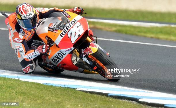 Honda rider Dani Pedrosa of Spain powers his machine during the third practice session of the Australian MotoGP Grand Prix at Phillip Island on...