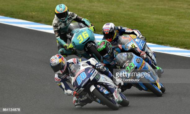 Honda rider Jorge Martin of Spain leads a pack during the qualifying session of the Moto3class at the Australian MotoGP Grand Prix at Phillip Island...
