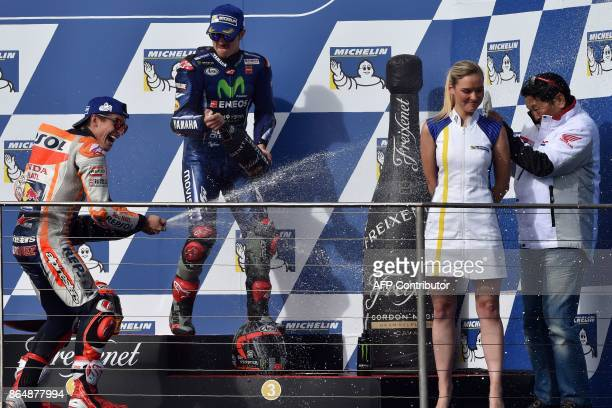 Honda rider Marc Marquez of Spain and thirdplaced Yamaha rider Maverick Vinales of Spain celebrate with champagne at the end of the Australian MotoGP...