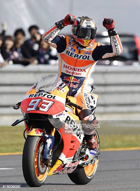 Honda rider Marc Marquez of Spain celebrates after winning the Japanese Grand Prix at Motegi Twin Ring in Tochigi Prefecture north of Tokyo on Oct 16...