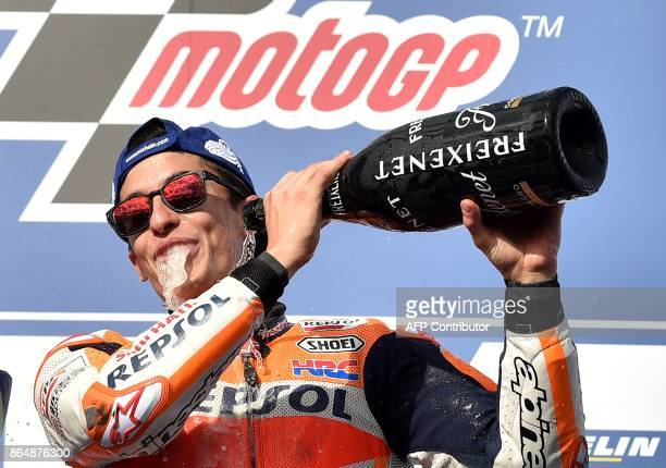 Honda rider Marc Marquez of Spain celebrates his victory on the podium at the end of the Australian MotoGP Grand Prix at Phillip Island on October 22...