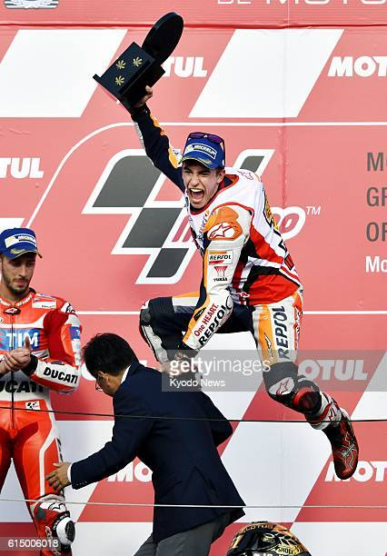 Honda rider Marc Marquez of Spain celebrates on the podium after winning the Japanese Grand Prix at Motegi Twin Ring in Tochigi Prefecture north of...