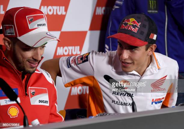 Honda rider Marc Marquez of Spain chats with Ducati rider Andrea Dovizioso of Italy prior to their press conference at Twin Ring Motegi circuit in...
