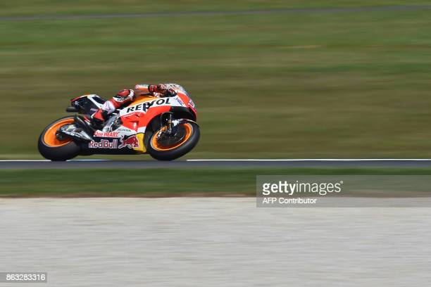TOPSHOT Honda rider Marc Marquez of Spain competes during the first practice session of the Australian MotoGP Grand Prix at Phillip Island on October...