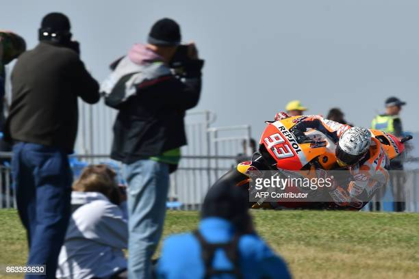 TOPSHOT Honda rider Marc Marquez of Spain competes during the second practice session of the Australian MotoGP Grand Prix at Phillip Island on...