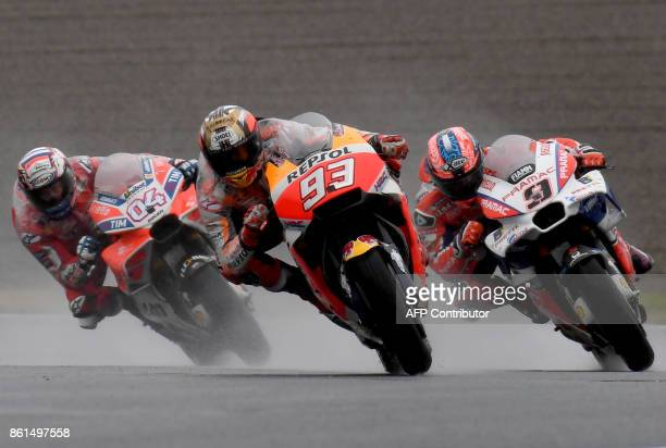 Honda rider Marc Marquez of Spain leads Ducati rider Andrea Dovizioso of Italy and Ducati rider Danilo Petrucci of Italy during the MotoGP Japanese...