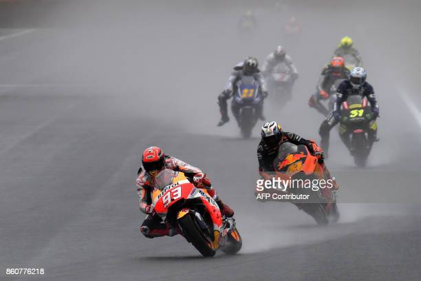 TOPSHOT Honda rider Marc Marquez of Spain leads the pack into the first turn during the second practice session of the MotoGP Japanese Grand Prix at...