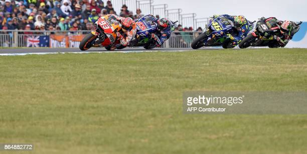Honda rider Marc Marquez of Spain leads Yamaha rider Maverick Vinales of Spain Yamaha rider Valentino Rossi of Italy and Yamaha rider Johann Zarco of...
