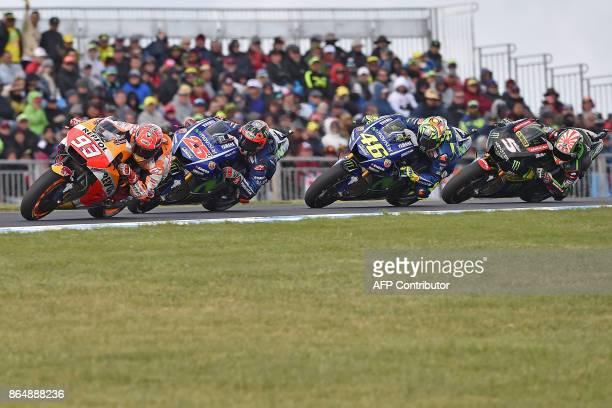 Honda rider Marc Marquez of Spain leads Yamaha rider Maverick Vinales of Spain Yamaha rider Valentino Rossi of Italy and Yamaha rider Johann Zarco of...
