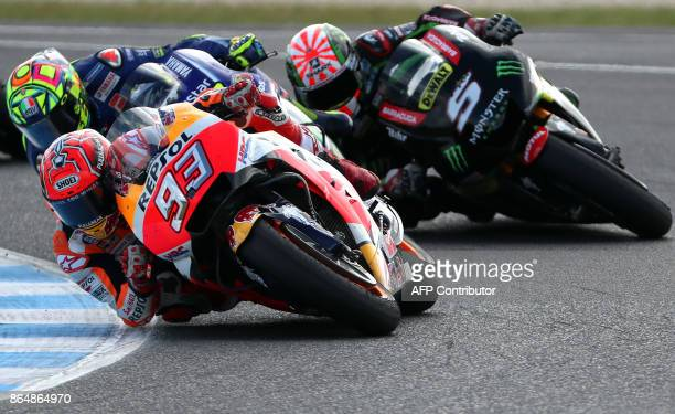 Honda rider Marc Marquez of Spain leads Yamaha rider Valentino Rossi of Italy and Yamaha Tech3 rider Johann Zarco of France during the Australian...