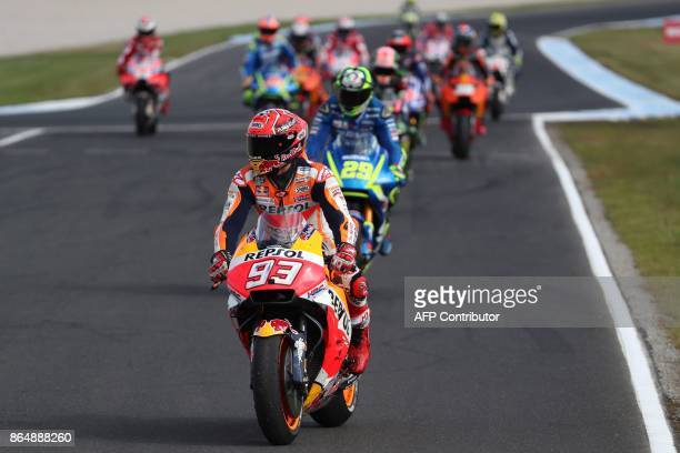 Honda rider Marc Marquez of Spain leaves the track following his victory in the Australian MotoGP Grand Prix at Phillip Island on October 22 2017 /...