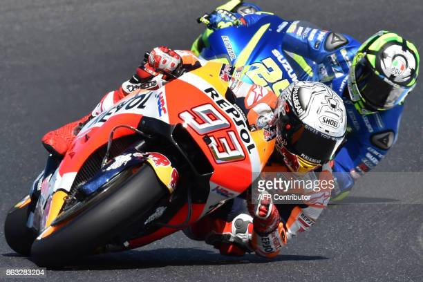 Honda rider Marc Marquez of Spain powers ahead of compatriot Movistar Honda rider Maverick Vinales during the first practice session of the...