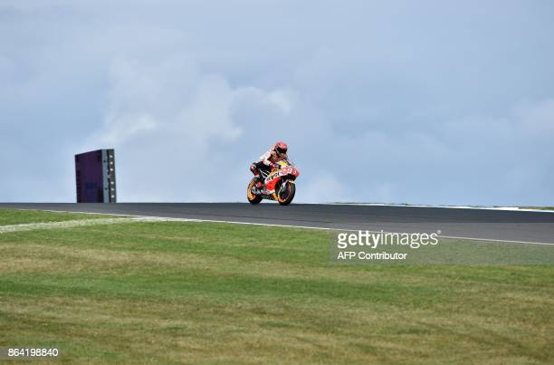 Honda rider Marc Marquez of Spain powers his machine during the qualifying session of the Australian MotoGP Grand Prix at Phillip Island on October...