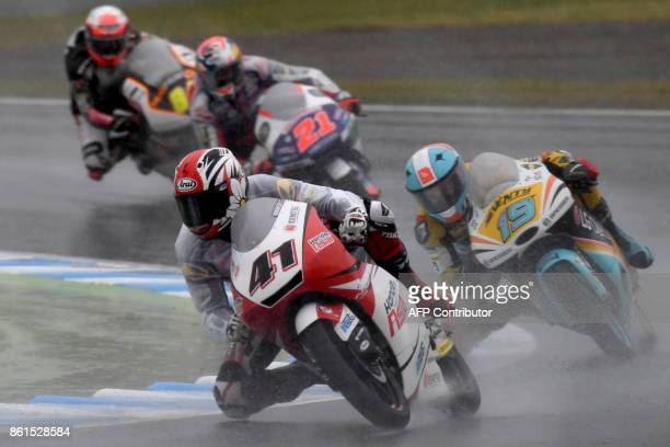 Honda rider Nakarin Atiratphuvapat of Thailand leads KTM rider Gabriel Rodrigo of Argentina during the Moto3 class of the MotoGP Japanese Grand Prix...