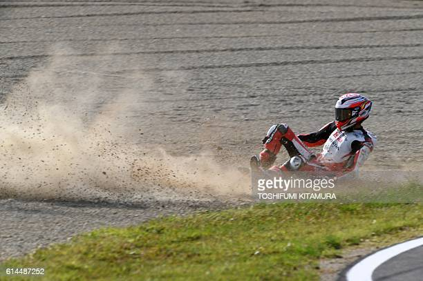 TOPSHOT Honda Team Asia's Japanese rider Hiroki Ono slides on the sand trap during the Moto3class second free practice session at the Japanese Grand...