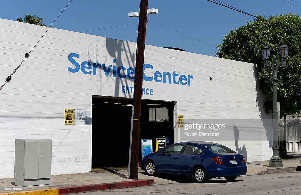 Honda vehicle enters a Honda sevice entrance on April 11 2013 in Los Angeles California Four automakers Honda Toyota Nissan and Mazda are recalling...