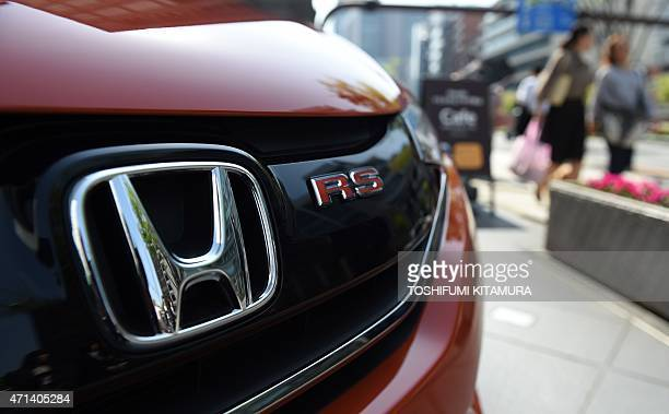 A Honda vehicle is on display in front of its headquarters in Tokyo on April 28 2015 Honda said that its fiscalyear net profit fell 89 percent to 44...