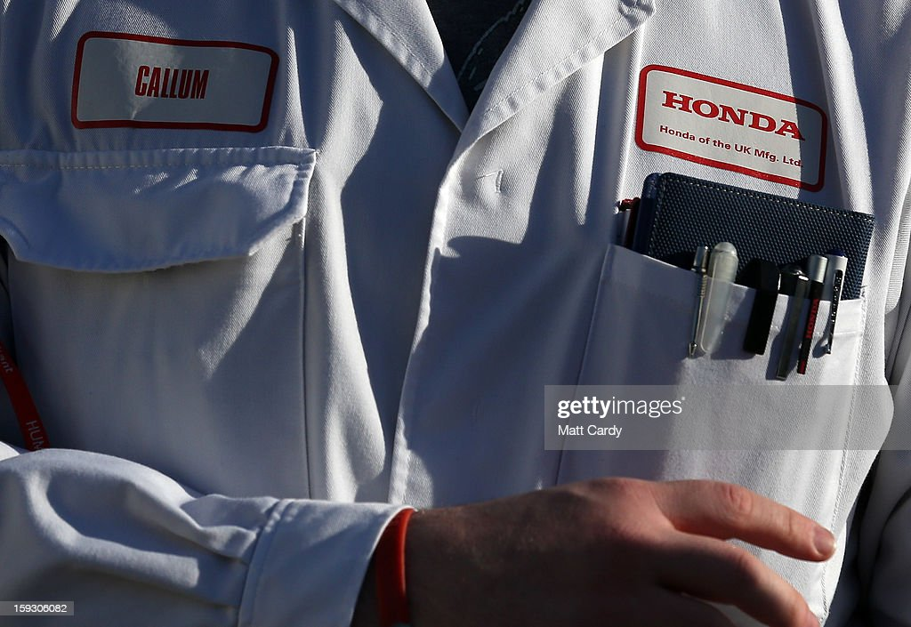 A Honda worker speaks to waiting media at the Honda car assembly plant following the announcement that the firm is to axe 800 jobs on January 11, 2013 in Swindon, England. The Japanese car maker, which employs 3500 people and assembles the Civic, Jazz and CR-V models at the Wiltshire plant, blames weak demand in the Eurozone for the cuts.
