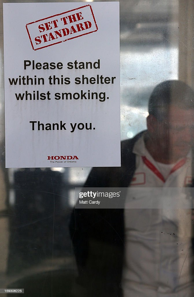 A Honda worker stands in the smoking shelter at the Honda car assembly plant following the announcement that the firm is to axe 800 jobs on January 11, 2013 in Swindon, England. The Japanese car maker, which employs 3500 people and assembles the Civic, Jazz and CR-V models at the Wiltshire plant, blames weak demand in the Eurozone for the cuts.