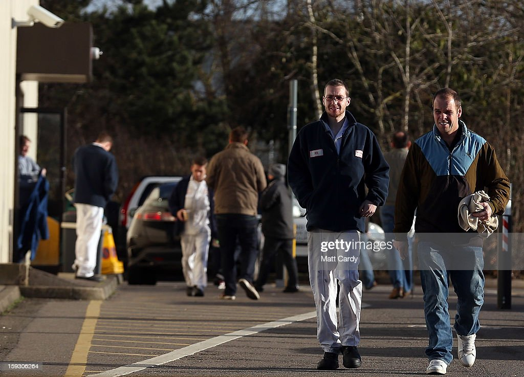 Honda workers leave their shift at the Honda car assembly plant following the announcement that the firm is to axe 800 jobs on January 11, 2013 in Swindon, England. The Japanese car maker, which employs 3500 people and assembles the Civic, Jazz and CR-V models at the Wiltshire plant, blames weak demand in the Eurozone for the cuts.