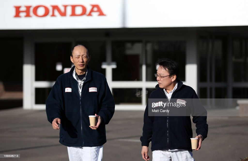 Honda workers walk from a building at the Honda car assembly plant following the announcement that the firm is to axe 800 jobs on January 11, 2013 in Swindon, England. The Japanese car maker, which employs 3500 people and assembles the Civic, Jazz and CR-V models at the Wiltshire plant, blames weak demand in the Eurozone for the cuts.