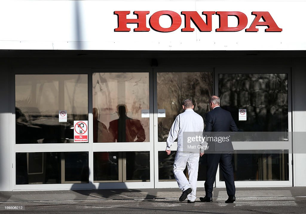 Honda workers walk into a building at the Honda car assembly plant following the announcement that the firm is to axe 800 jobs on January 11, 2013 in Swindon, England. The Japanese car maker, which employs 3500 people and assembles the Civic, Jazz and CR-V models at the Wiltshire plant, blames weak demand in the Eurozone for the cuts.
