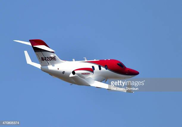 A HondaJet flies over toward Tokyo at Sendai Airport on April 23 2015 in Natori Miyagi Japan The 13meterlong aircraft can carry seven passengers and...