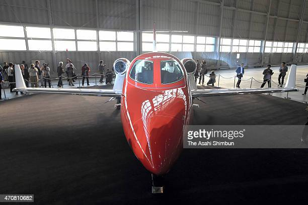 A HondaJet is displayed at a hangar at Tokyo International Airport on April 23 2015 in Tokyo Japan The 13meterlong aircraft can carry seven...