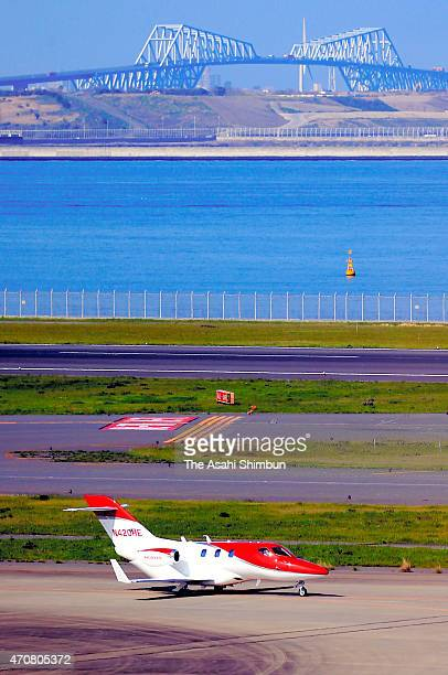 A HondaJet lands at Tokyo International Airport on April 23 2015 in Tokyo Japan The 13meterlong aircraft can carry seven passengers and is priced at...