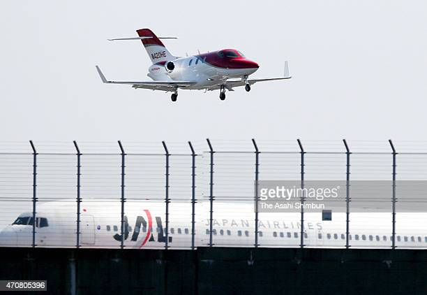 A HondaJet prepare to land at Tokyo International Airport on April 23 2015 in Tokyo Japan The 13meterlong aircraft can carry seven passengers and is...