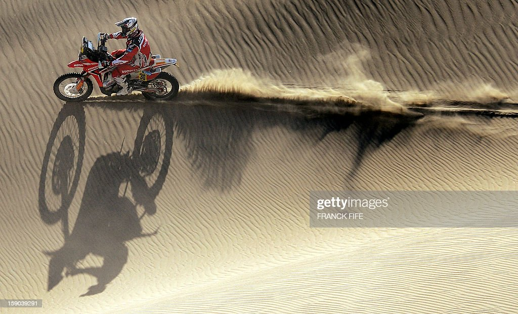 Honda's biker Javier Pizzolito of Argentina competes during the Stage 2 of the Dakar 2013 in Pisco, Peru, on January 6, 2013. The rally will take place in Peru, Argentina and Chile from January 5 to 20. AFP PHOTO / FRANCK FIFE