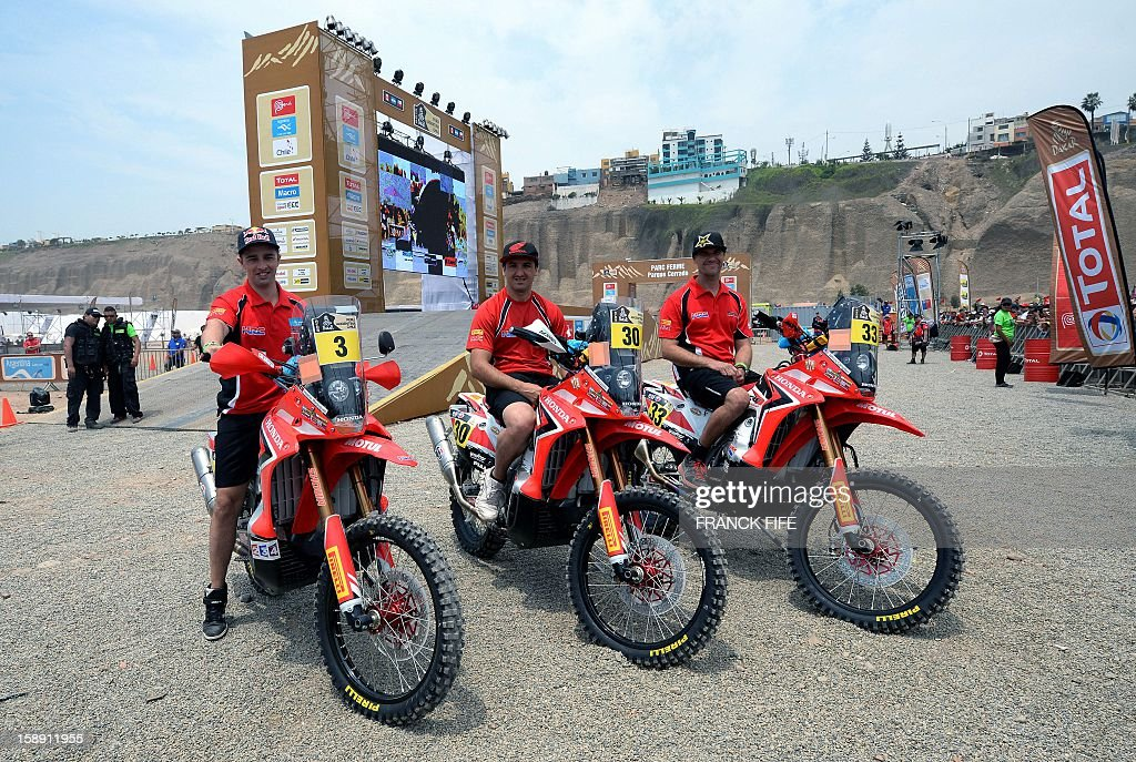 Honda's bikers Rodriguez Helder of Portugal, Javier Pizzolito of Argentina and Johnny Campbell of USA pose in Lima on January 3, 2013, ahead of the 2013 Dakar Rally which this year will thunder through Peru, Argentina and Chile from January 5 to 20. AFP PHOTO / FRANCK FIFE / AFP / FRANCK FIFE