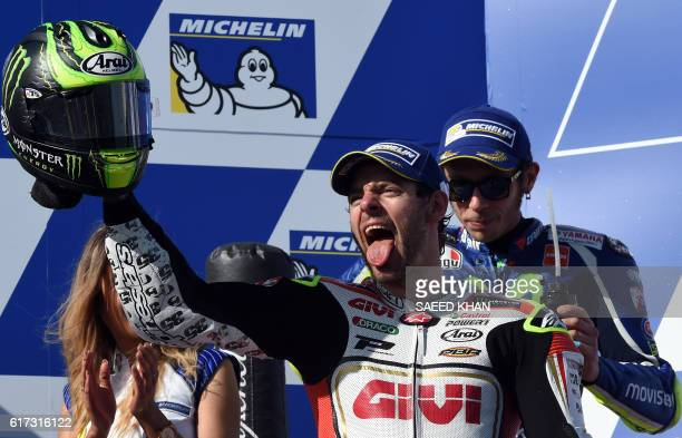 LCR Honda's British rider Cal Crutchlow celebrates his victory on the podium after the MotoGP race at the Australian Grand Prix at Phillip Island on...