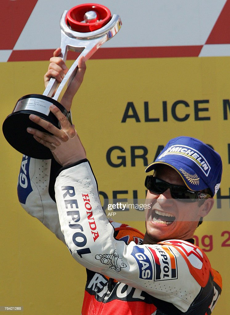 Honda's Dani Pedrosa from Spain celebrates his victory in the MotoGP category race of the German motorcycling Grand Prix 15 July 2007 at the...