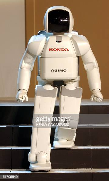 ASIMO Honda's hightech humanoid robot walks down steps in a display of its mobility during its first North American appearance at a news conference...