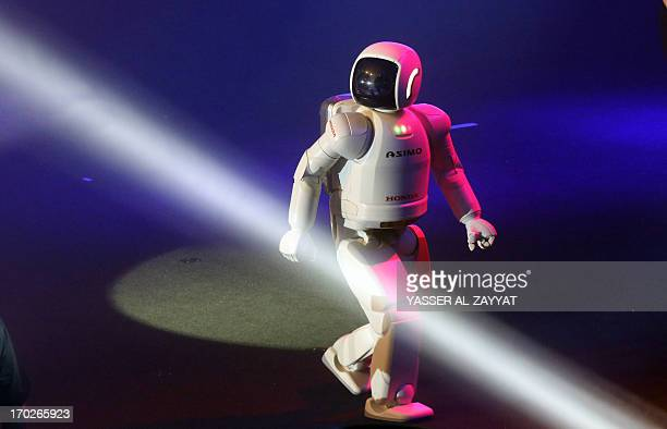 ASIMO Honda's Humanoid Robot performs on the occasion of the opening a new showroom for Honda cars hosted by alGhanem motors in Kuwait City on June...