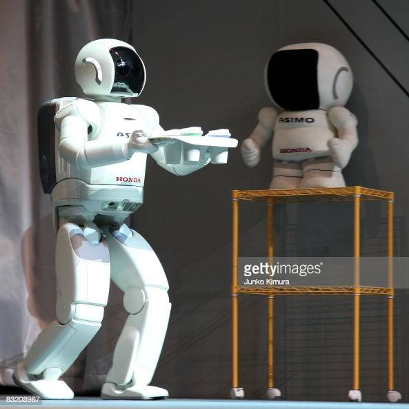 Honda's humanoid walking robot ASIMO carries drinks during the Robo_Japan 2008 Press Preview at Pacifico Yokohama on October 10 2008 in Yokohama...