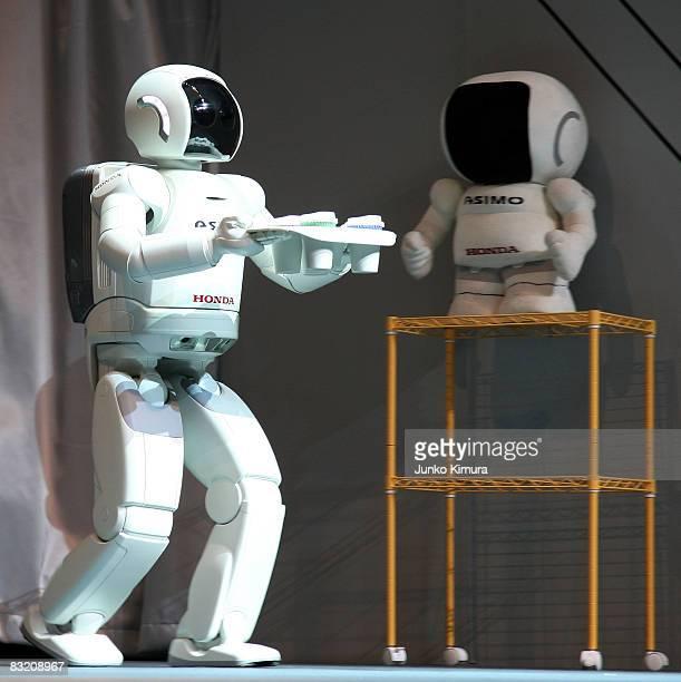 Honda's humanoid walking robot ASIMO carries drinks during the Robo_Japan 2008 Press Preview at Pacifico Yokohama on October 10 2008 in Yokohama...