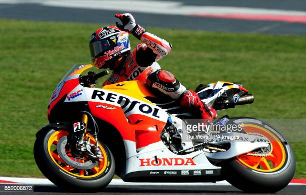 Honda's Marc Marquez waves to fans after qualifying in pole position at Silverstone Northamptonshire